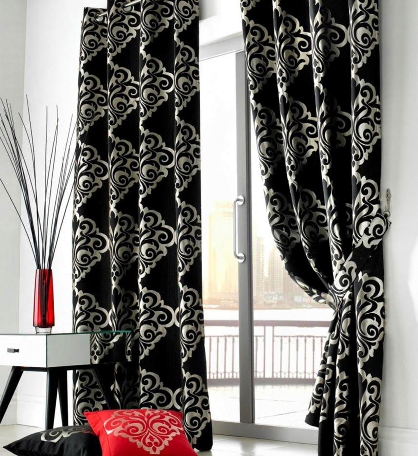 contemporary-white-living-room-with-glass-door-and-black-curtains-floral-pattern-915x999